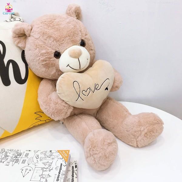 Gấu teddy cười ôm tim love