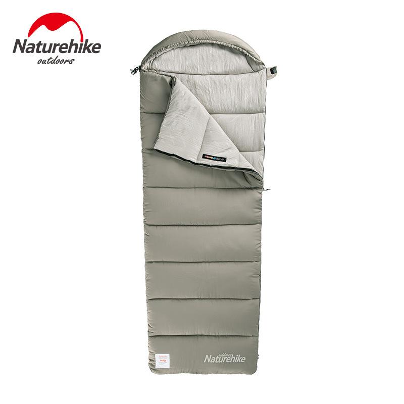 Túi ngủ màu xám, hình dạng hình chữ nhật, kéo khoá hở phần đầu