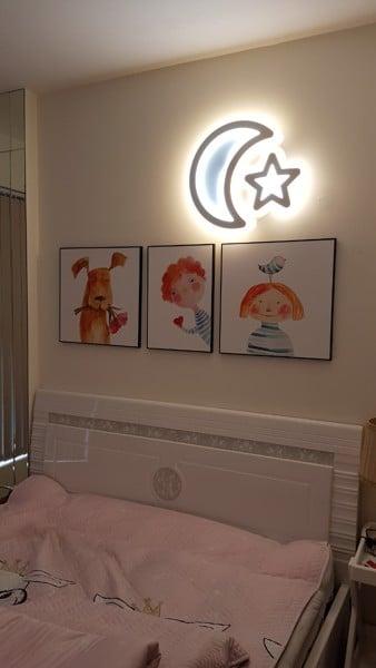 vị trí treo tranh trong phòng bé