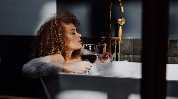 beauty girl and wine in the bathroom