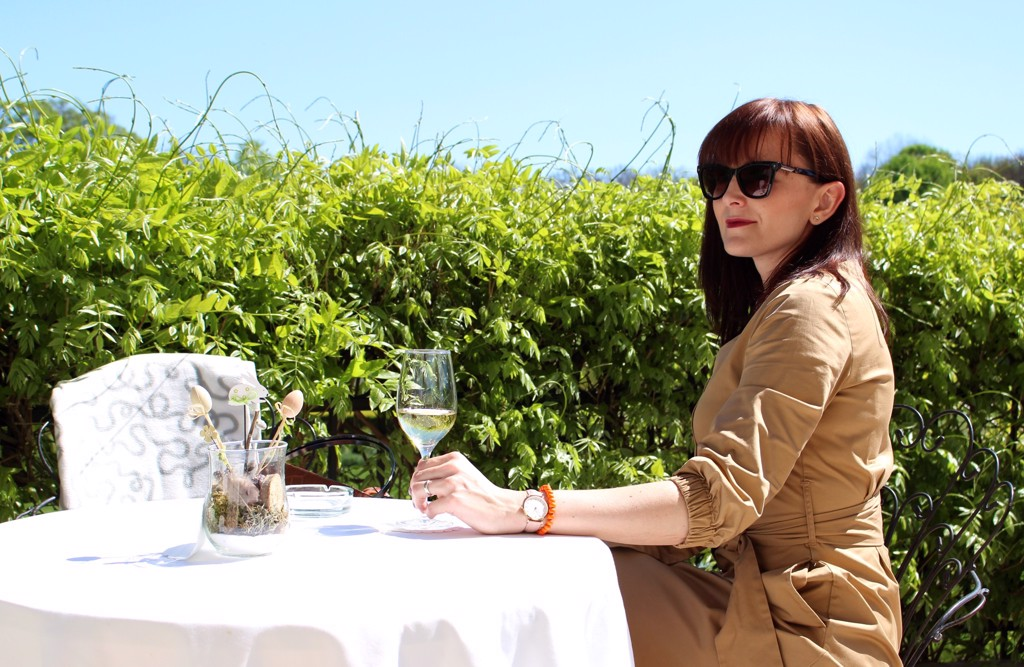 elegant women drinking wine outside